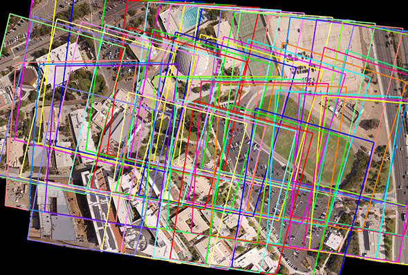 A collection of unmanned aerial vehicle imagery used as input for creation of an orthomosaic. The resulting orthophoto is overlaid with several bounding boxes to show individual image boundaries.